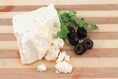 Feta cheese and olives Stock Photography