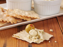 Feta cheese and olives on flatbread crackers Stock Image