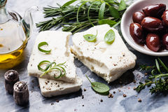 Feta cheese with olives and green herbs Stock Photography