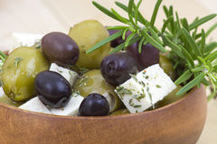 Feta cheese and olives with herbs Stock Photography