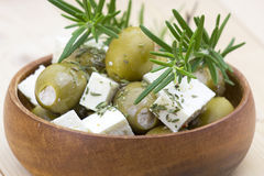Feta cheese and olives with herbs Stock Images