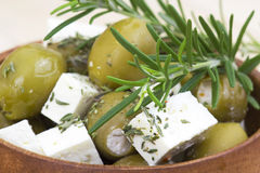 Feta cheese and olives with herbs Stock Photo