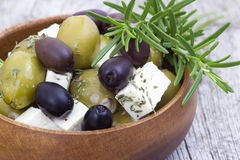 Feta cheese and olives with herbs Royalty Free Stock Photography