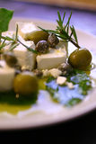 Feta cheese with olives and oil Royalty Free Stock Photo