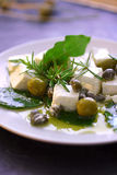 Feta cheese with olives and oil Royalty Free Stock Photography