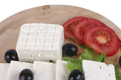 Feta cheese with olives on plate Royalty Free Stock Photography