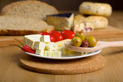 Feta cheese, olives and red chilli pepper Stock Photos