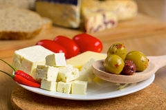 Feta cheese, olives and tomatos on a plate Stock Photos