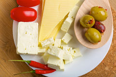 Feta cheese, olives and tomatos on a plate Stock Photo