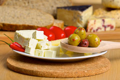 Feta cheese, olives and tomatos on a plate Stock Photography