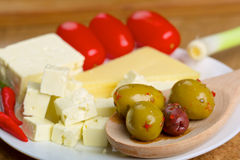 Feta cheese, olives and tomatos on a plate Royalty Free Stock Images