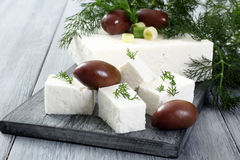 Feta cheese. With oliveson gray background Stock Photo