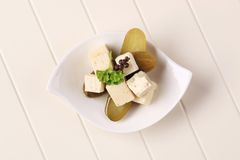 Feta cheese and pickles Royalty Free Stock Images