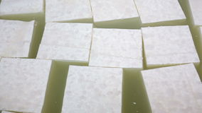 Feta cheese production cubes stock footage