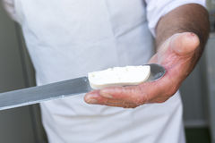 Feta cheese production knife cutting Royalty Free Stock Photo