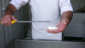 Feta cheese production knife cutting stock video footage
