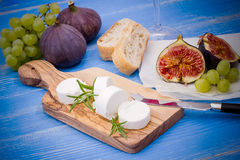 Feta cheese with ripe figs and grapes Stock Photos