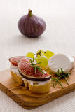 Feta cheese with ripe figs and grapes Stock Photo