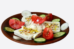 Feta cheese salad 1. Feta cheese cut in slices, with fresh vegetables, dry herb spices and olive oil - the ingredients for a healthy greek salad Royalty Free Stock Photography