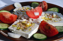 Feta cheese salad 11. Feta cheese cut in slices, with fresh vegetables, dry herb spices and olive oil - the ingredients for a healthy greek salad Royalty Free Stock Images