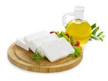 Feta cheese slices on wood Stock Photos