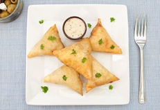 Feta cheese and spinach pastries Royalty Free Stock Photos