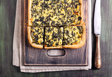 Feta cheese and spinach puff pastry pie Stock Photography
