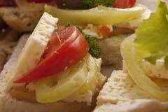 Feta cheese and tomato on white bread Royalty Free Stock Photos