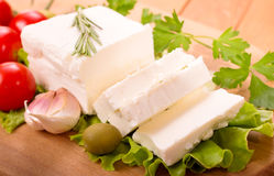Feta cheese. With vegetables top view Stock Photos