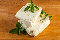 Feta cheese on wood board Royalty Free Stock Image