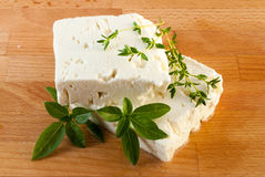 Feta cheese on wood board Stock Images