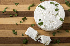 Feta cheese on wooden board Royalty Free Stock Photography