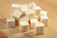 Feta cheese on wooden cutting board Stock Photo