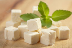 Feta cheese on wooden cutting board Stock Image