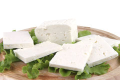 Feta cheese on wooden plate Royalty Free Stock Photo