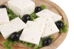 Feta cheese on wooden plate Royalty Free Stock Images