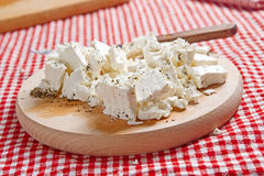 Feta cheese on wooden plate Royalty Free Stock Photos
