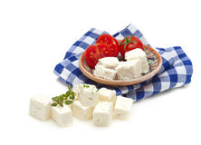 Feta cubes and tomato Stock Images