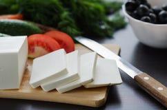 Feta del formaggio sul bordo immagine stock libera da diritti