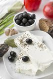 Feta, fetax, olives, spices, cheese, pickle, bay leaf, garlic, Greek food. Feta, fetax, cheese, pickle, olives, spices, bay leaf, garlic, Greek food stock images
