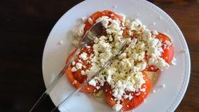 Feta grec sur des tomates Photographie stock