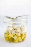 Feta in olive oil Stock Photography