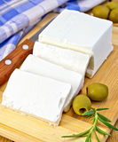 Feta with olives on board with blue cloth Stock Image