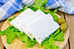 Feta with olives and lettuce on board Royalty Free Stock Photo