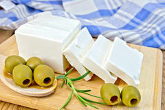 Feta with olives and rosemary on board Royalty Free Stock Photos