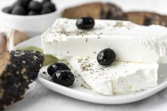 Feta, olives, spices, cheese, pickle, Greek food. Feta, olives, spices, cheese royalty free stock photos