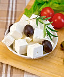 Feta with olives and tomato on brown cloth Stock Image