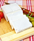 Feta with olives and tomatoes on a red fabric Royalty Free Stock Image