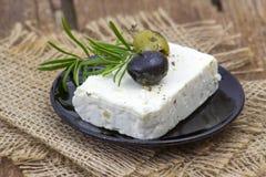 Feta oliwki z ziele w oliwa z oliwek i ser zdjęcie stock