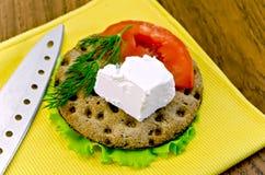 Feta piece with tomato on crispbread Stock Images
